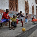 Children playing football in front of a church in Bukum, Accra in Ghana. © Andrew Esiebo / Twenty Ten Project / Africa Media Online