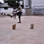 Unidentified children playing football on the street of Fort James in Accra, Ghana.