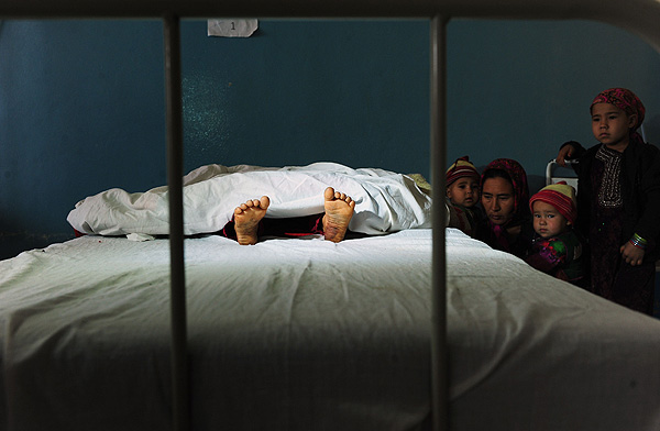 Raped Girl  This picture won a Gold Medal, General News (Singles) in the 9th CHIPP Contest The family of a five-year-old Afghan girl who was allegedly raped by a 22-year-old man, looks on as she lies in a hospital bed in Kaldar district of Balk Province of Mazar-i-Sharif, Afghanistan, on November 12, 2012.  The alleged rapist who was a neighbour was later detained by police.  PHOTO: Qais Usyan / AFP