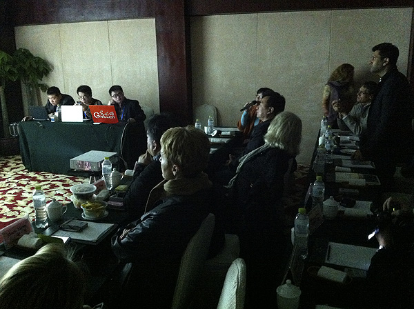 Judging the 9th China International Press Photo (CHIPP) Awards. A panel of 13 judges spend long hours over three-and-a-half days judging the awards. PHOTO: David Larsen/Africa Media Online