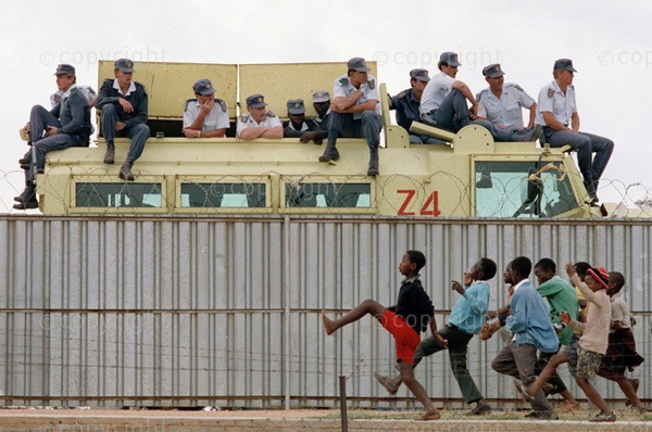 Youth and police in Tokoza, 1991. PHOTO: Graeme Williams / South Photographs / Africa Media Online
