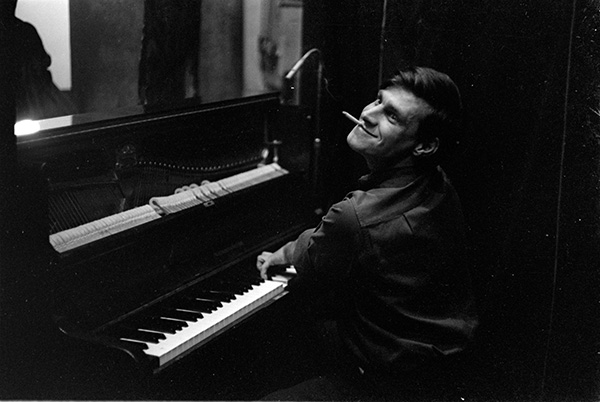 Chris McGregor playing the piano with the Blue Notes at Rondebosch Town Hall, Rondebosch, Cape Town; 1964