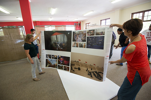 Curators Femke van der Valk (left) of World Press Photo and Charmaine Naidoo (right) contracted to Africa Media Online start the process of hanging the World Press Photo Exhibition 2017 in the Raymond Slater Library at Hilton College ahead of the Hilton Arts Festival 2017. Africa Media Online partnered with World Press Photo to bring the Exhibition to KwaZulu-Natal province in South Africa for the first time in almost 20 years.