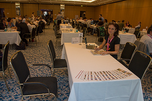 Rosanne Larsen, founder of Africa Media Online's (AMO) picture library at the AMO table at CEPIC. The tables area at CEPIC provide an opportunity for agencies around the World to meet one another and set up distribution partnerships. AMO has been present at CEPIC since early 2000s and has developed a distribution network of close to 40 partners in all the World's major image markets.